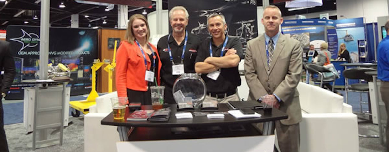 Team members from Air Services and Dakota Air Parts at Heli-Expo booth